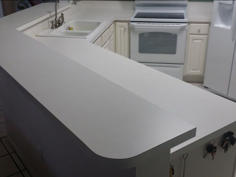 A Large Laminate Kitchen Countertop In Orlando Home Before Refinishing  Installing Granite Overlay