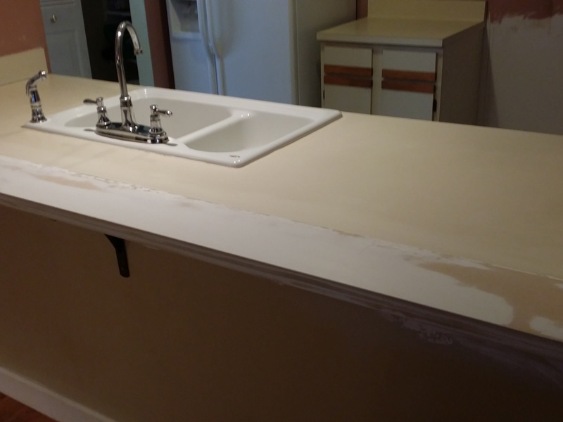 a large kitchen counter in Orlando home ready for refinishing