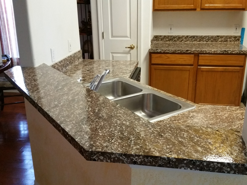 the same countertop after being refinished with a custom granite overlay