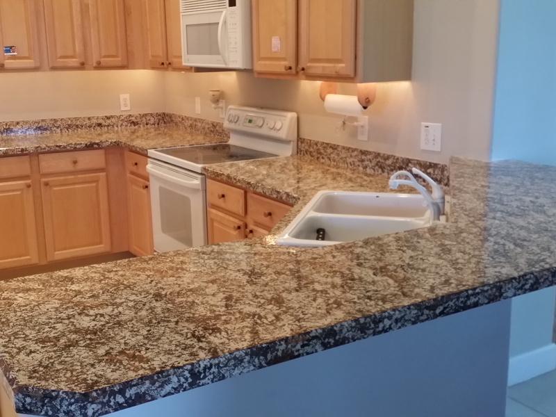 a large kitchen countertop after grantite countertop overlay installed
