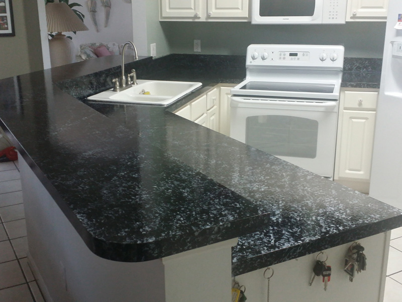 a large kitchen countertop in orlando after refinising with a black granite overlay